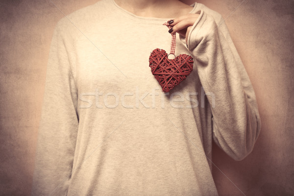 beautiful young woman hand holding heart shaped toy on the wonde Stock photo © Massonforstock