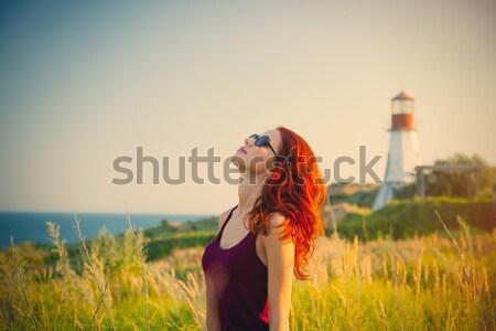 Belo mulher jovem binóculo maravilhoso farol primavera Foto stock © Massonforstock