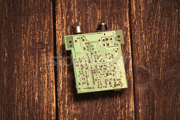 photo of cool small modern microchip on the wooden brown backgro Stock photo © Massonforstock