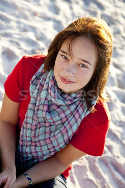 Beautiful brunet girl sitting at sand Stock photo © Massonforstock