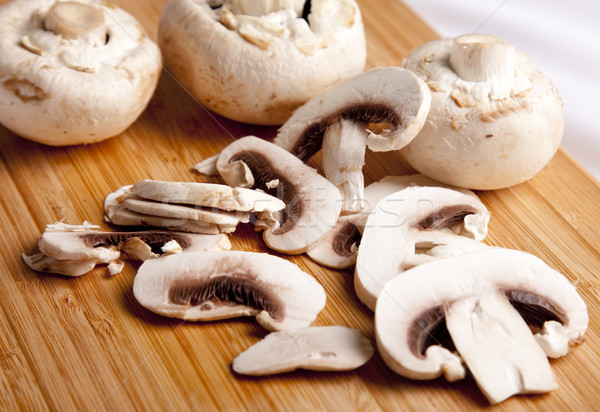 Field mushrooms cut by segments Stock photo © Massonforstock