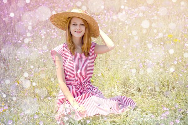 Gyönyörű vörös hajú nő lány kalap park virágok Stock fotó © Massonforstock