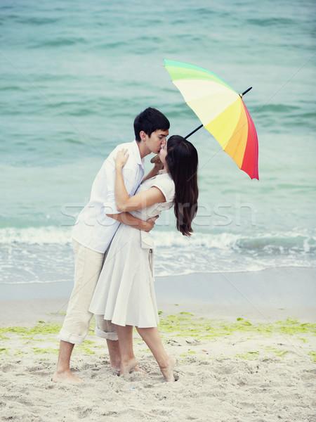 Foto stock: Pareja · besar · paraguas · playa · nina · mujeres