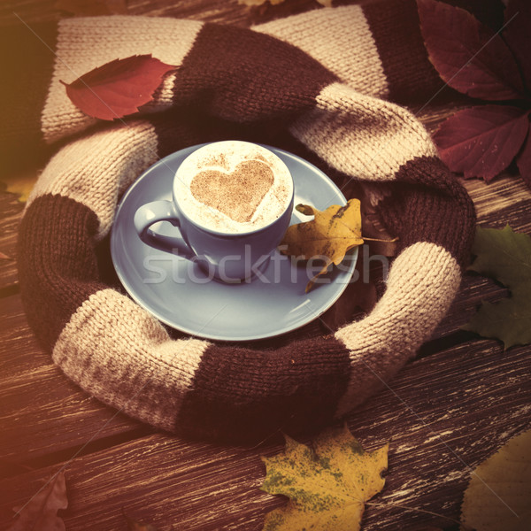 Autumn leafs, scarf and coffee cup on wooden table. Stock photo © Massonforstock