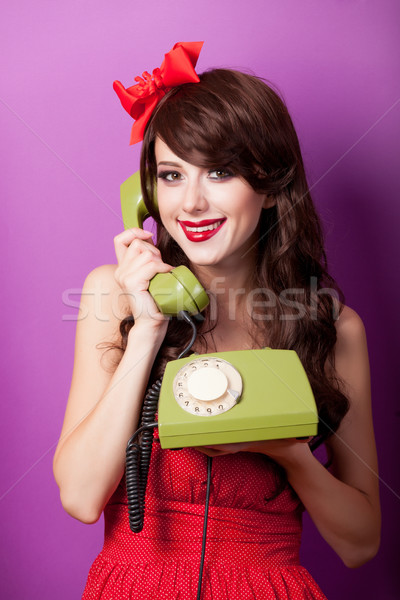 photo of beautiful young woman with retro phone on the wonderful Stock photo © Massonforstock