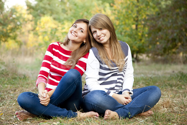 Portrait of redhead and brunette girls at outdoor. Stock photo © Massonforstock