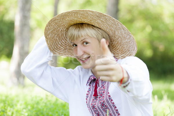 Young slav teen at green meadow in national clothing. Stock photo © Massonforstock