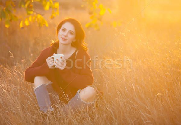 Mulher copo chá café sessão grama Foto stock © Massonforstock