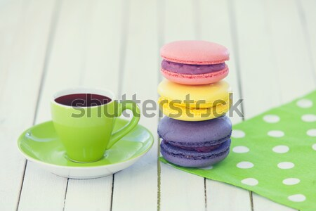 Cup of coffee and macarons with window on wooden background Stock photo © Massonforstock