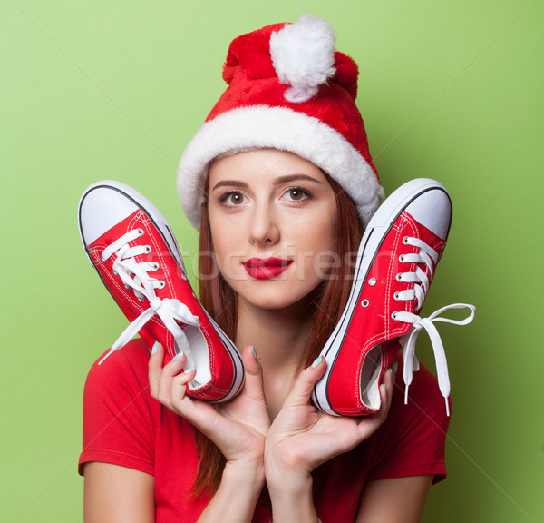women in christmas hat with red gumshoes  Stock photo © Massonforstock