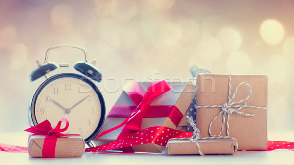 big alarm clock, red ribbon and beautiful gifts on the fairy lig Stock photo © Massonforstock