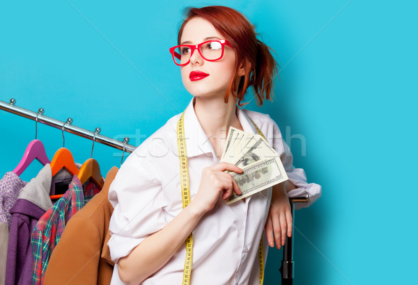 photo of beautiful young woman with centimeter and money near cl Stock photo © Massonforstock