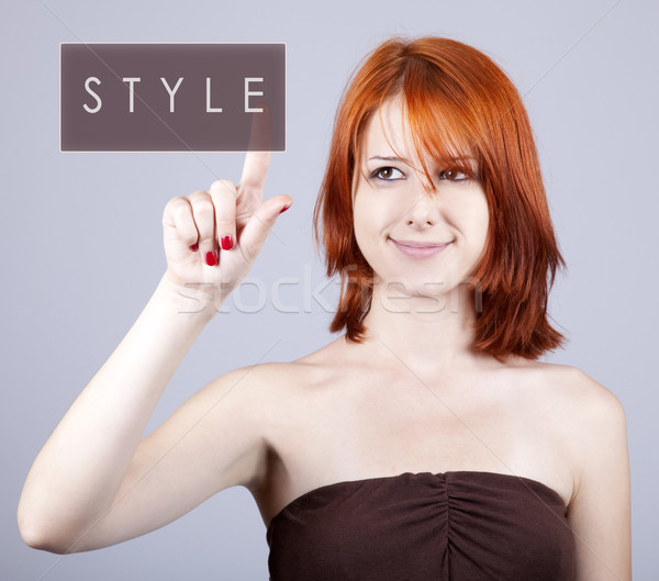 Young fashion girl push abstract button. Stock photo © Massonforstock
