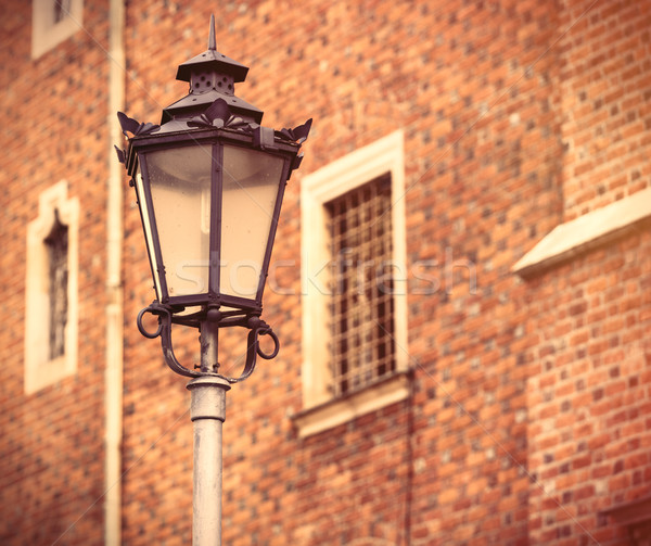 photo of beautiful lamp post and vintage old windows in Wroclaw, Stock photo © Massonforstock
