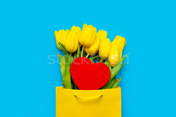 bunch of beautiful yellow tulips in cool shopping bag and heart  Stock photo © Massonforstock
