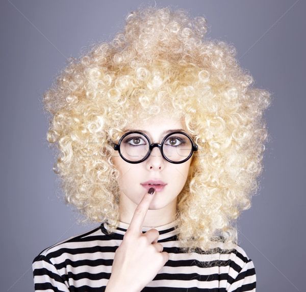 Portrait of funny girl in blonde wig.  Stock photo © Massonforstock