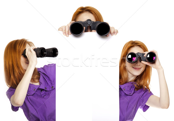 Three teen redhead girls with binoculars isolated on white backg Stock photo © Massonforstock