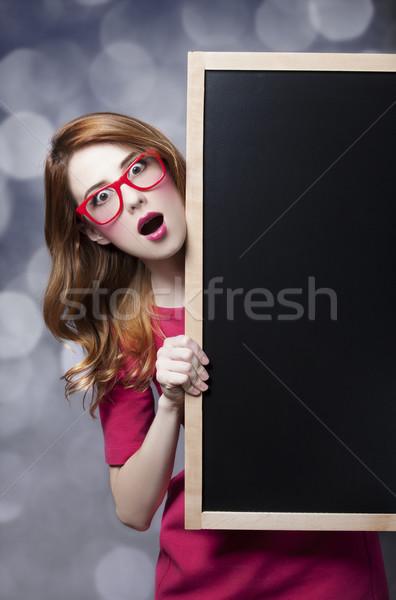 Redhead student with blackboard. Stock photo © Massonforstock