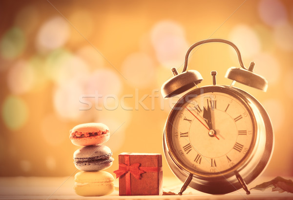 Saat fransız macarons hediye çalar saat sarı Stok fotoğraf © Massonforstock