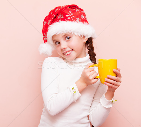 girl with cup in Santa Claus hat Stock photo © Massonforstock