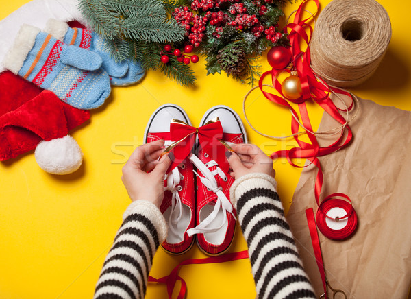 Woman wrapping red gumshoes  Stock photo © Massonforstock