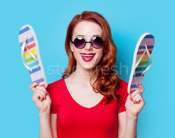 a135151fff17  6877242 girl in red dress with flip flops by Massonforstock Stock photo