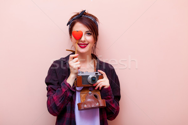 portrait of a young woman with camera and toy Stock photo © Massonforstock