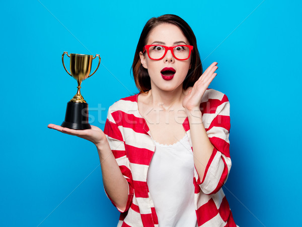 young surprised woman with cup trophy Stock photo © Massonforstock