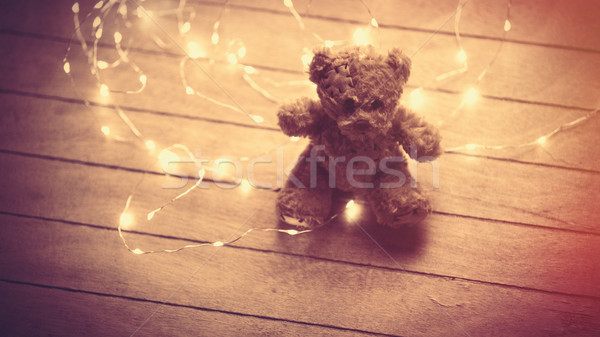cute fluffy teddy bear and bright garland on the wonderful brown Stock photo © Massonforstock
