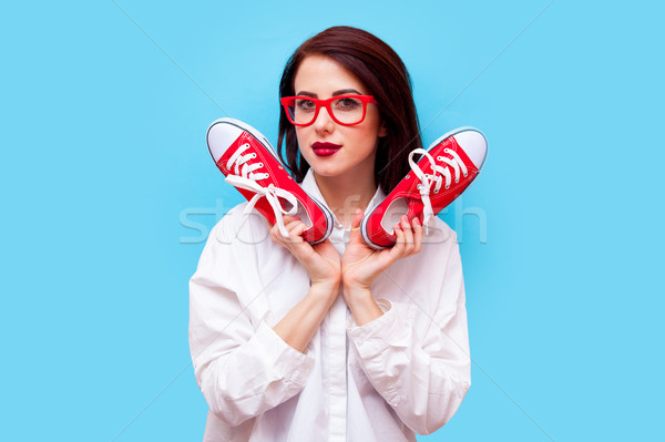 beautiful young woman with gumshoes standing in front of the won Stock photo © Massonforstock