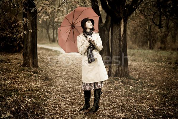 девушки зонтик парка дождливый день фото Сток-фото © Massonforstock