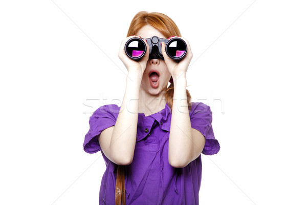 Stock photo: Teen redhead girl with binoculars isolated on white background
