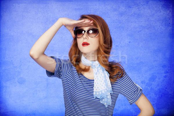 American redhead girl in sunglasses.  Stock photo © Massonforstock