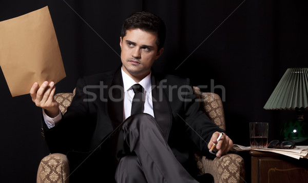 Man with file sitting in vintage armchair Stock photo © Massonforstock
