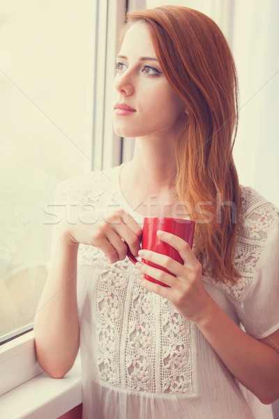 美しい 若い女性 カップ ウィンドウ コーヒー 市 ストックフォト © Massonforstock