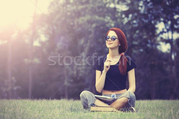 Fiatal lány indie stílus ruházat notebook zöld fű Stock fotó © Massonforstock