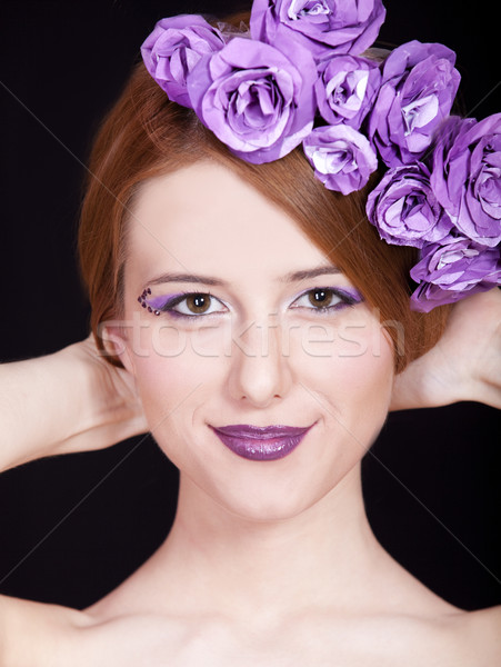Portrait of beautiful redhead girl with style make-up and flower Stock photo © Massonforstock