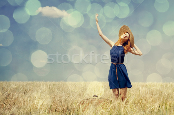 Vörös hajú nő lány tavasz búzamező fotó bokeh Stock fotó © Massonforstock