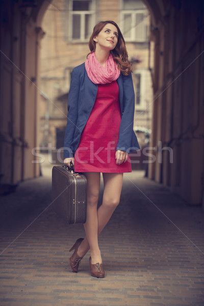 portrait of a beautiful girl on the street.  Photo in vintage st Stock photo © Massonforstock