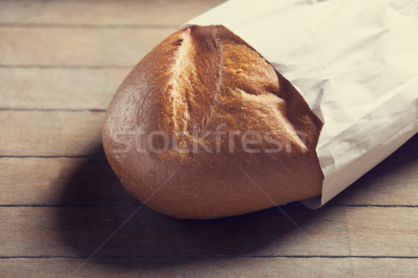 Delicious bread on a wood table Stock photo © Massonforstock