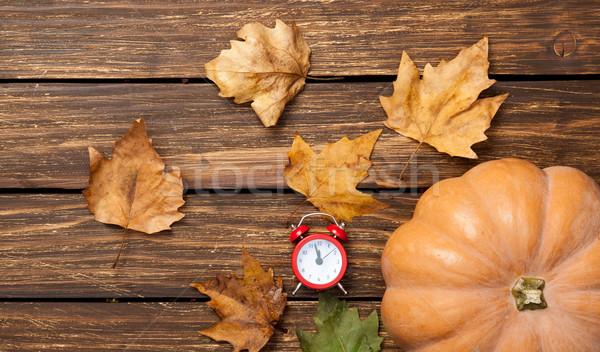 Pumpkin and alarm-clock Stock photo © Massonforstock