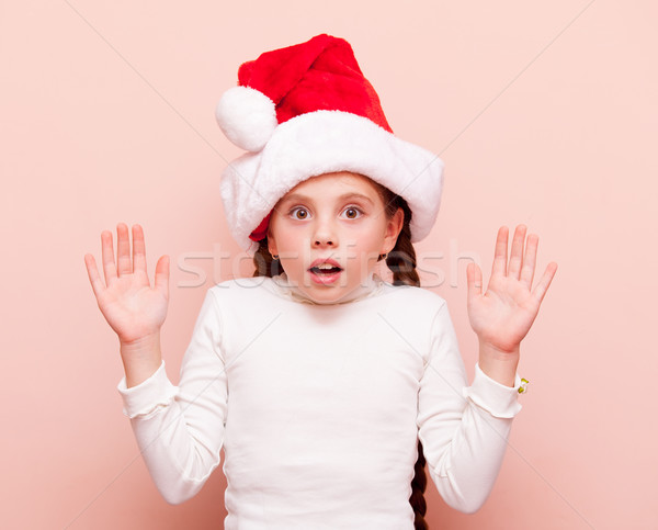 girl with pigtails in Santa Claus hat  Stock photo © Massonforstock