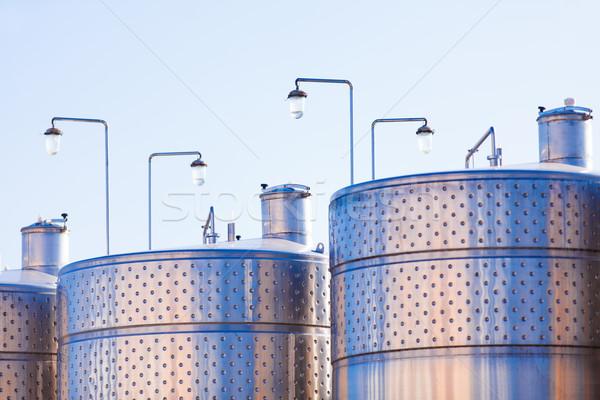 Metal pojemność wina Błękitne niebo budynku budowy Zdjęcia stock © Massonforstock