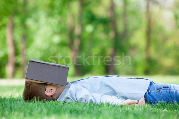 young boy with a book slipping  Stock photo © Massonforstock