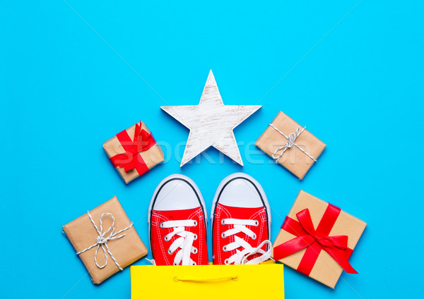 big red gumshoes in cool shopping bag, star shaped toy and beaut Stock photo © Massonforstock