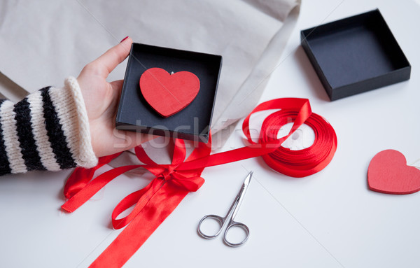 white caucasian hand holding heart shaped toy in box on the wond Stock photo © Massonforstock