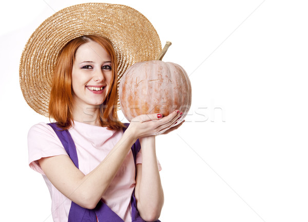 Young girl in overalls with pumpkin. Stock photo © Massonforstock