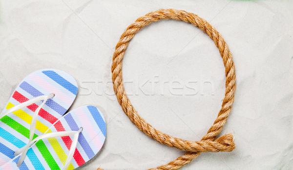 Színes papucs kötél fehér homok fotó magasról fotózva Stock fotó © Massonforstock