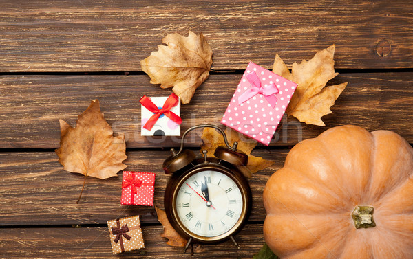 Pumpkin and alarm-clock with gifts Stock photo © Massonforstock