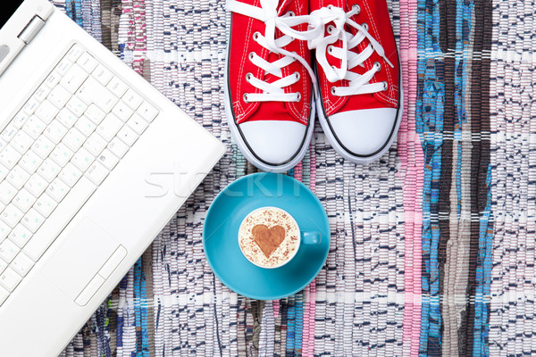 cup, gumshoes and laptop lying on the table Stock photo © Massonforstock